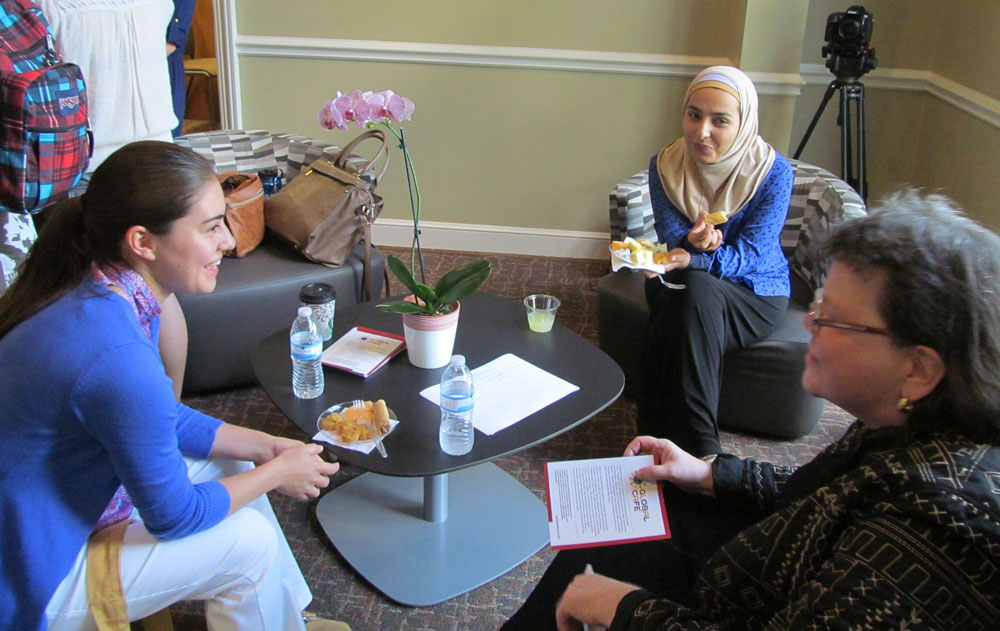Fulbright campus adviser Dr. Beverly Hawk chats with Fulbright winner to Malaysia Haglaeeh Contreras and UA student Hailah Saeed during the Global Cafe-Fulbright reception.