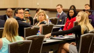 Members of the newly formed Community Affairs board of advisors listen intently to a fellow board member at the inaugural meeting of the group, held on campus in April. The group will return to campus for its next full work session in late September.