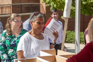 Departmental United Way representatives pick up their forms.