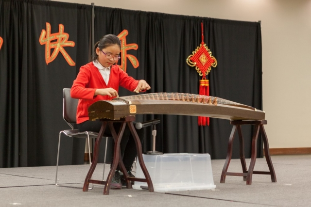 Lidan Zhang's playing of the Chinese guzheng, a traditional stringed instrument, drew enthusiastic applause.