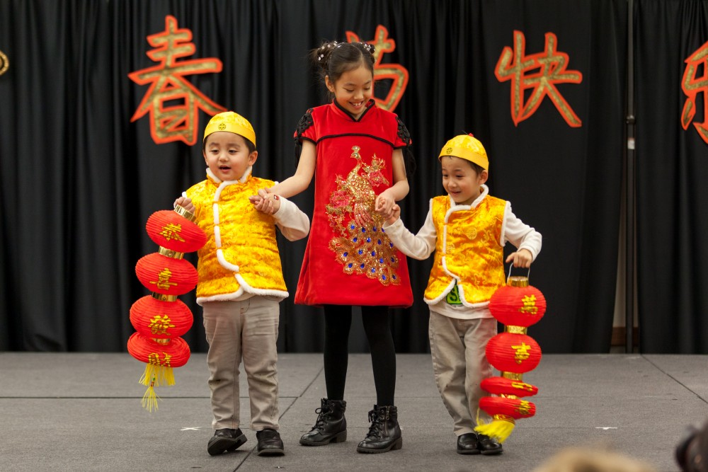 Children tell the audience what their hopes are for the new year.