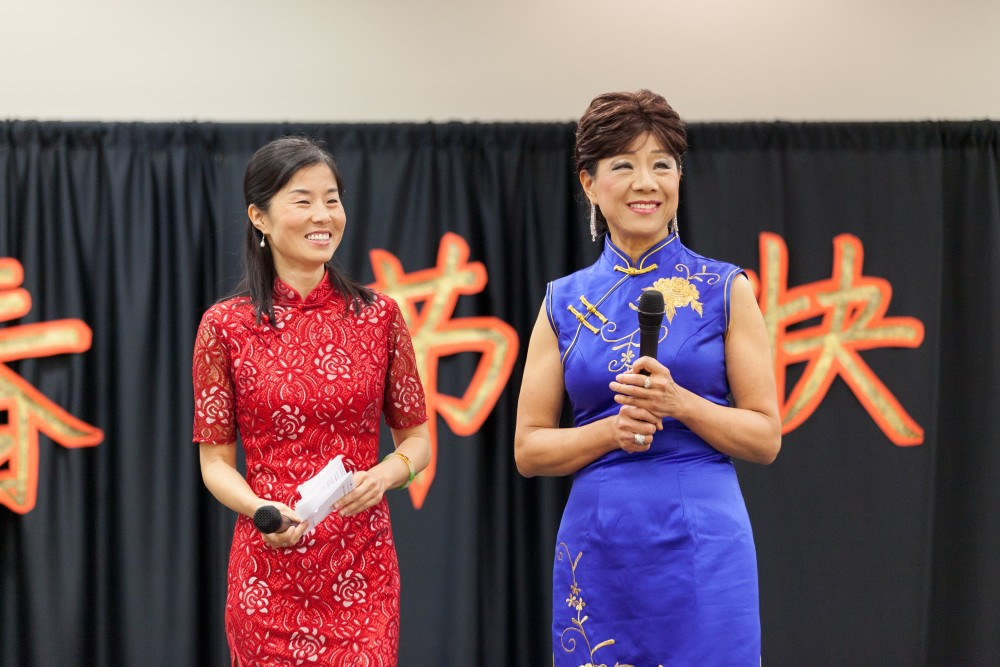 Ying Qin and Yun Fu introduce the Zumba performance.