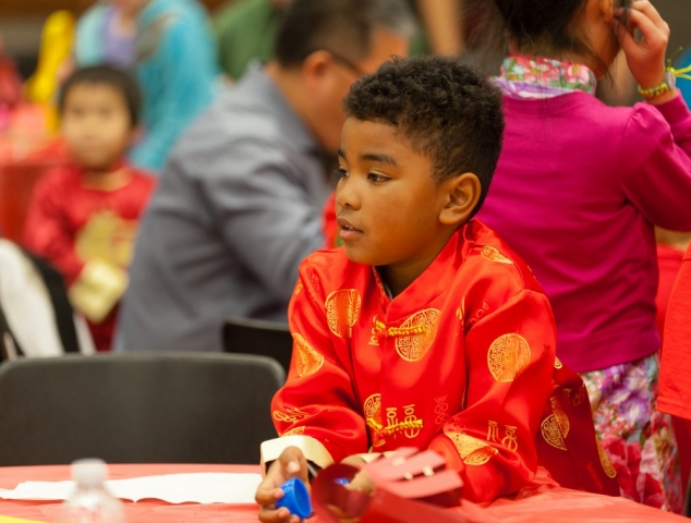 Youngsters like these (above and right) attended the performance dressed in Chinese attire.