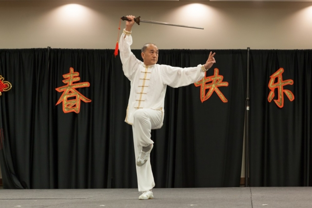 Wenting Liang performs Tai Chi with traditional sword.