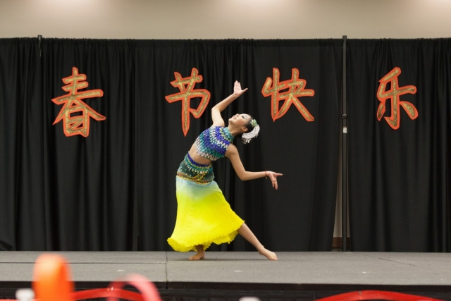 Junqi Sun gives a solo performance of the Chinese Dai dance.