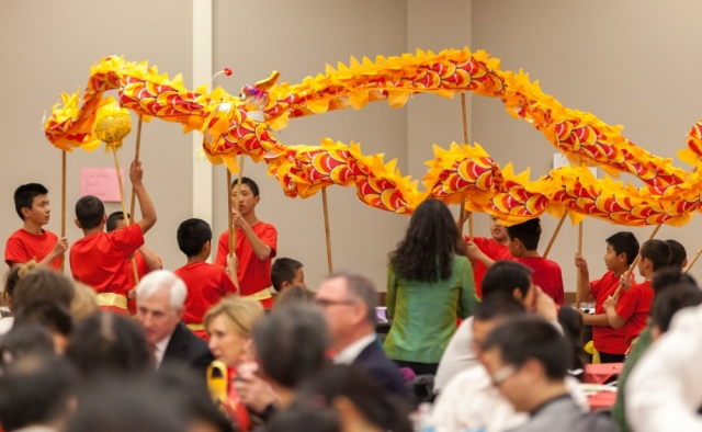 Dragon Dance youngsters hold high their banners.