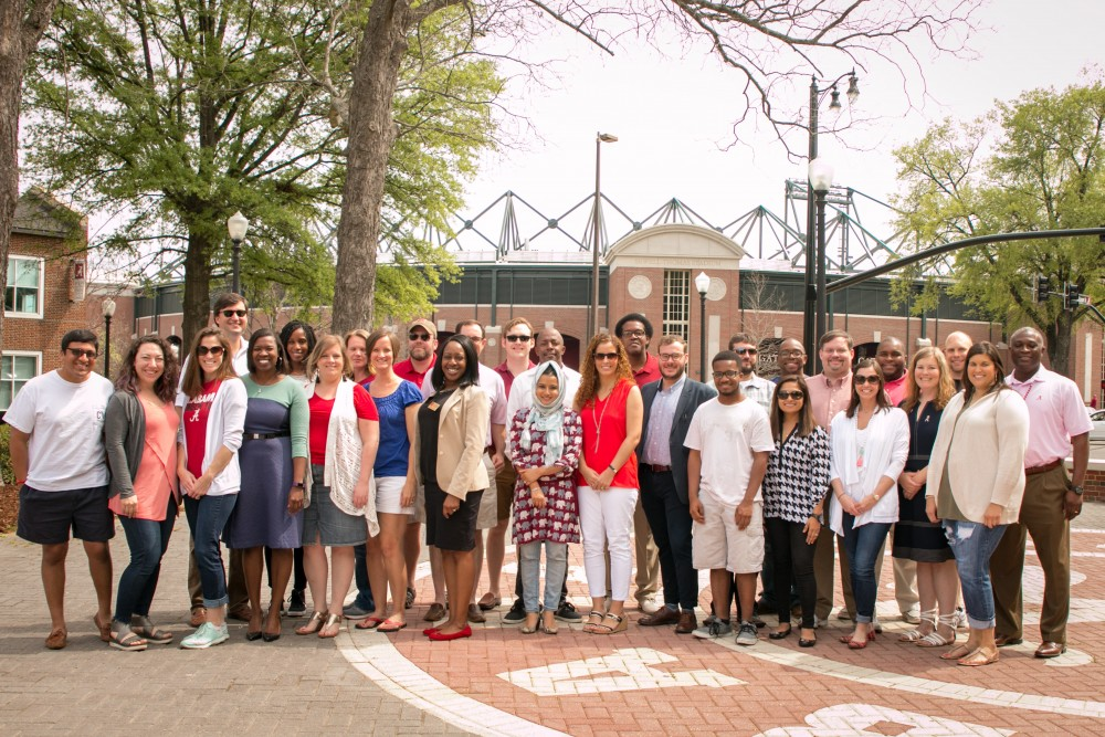 The members of the UA Division of Community Affairs Board of Advisors gather for a group photo prior to the April 2 UA vs. Arkansas baseball game.