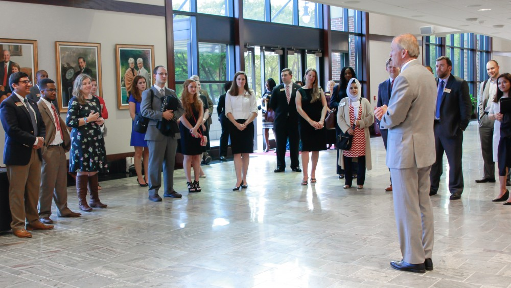 Dr. Stuart R. Bell, UA president, thanks members of the Community Affairs Board of Advisors for their service to their alma mater prior to the BOA dinner meeting April 3.