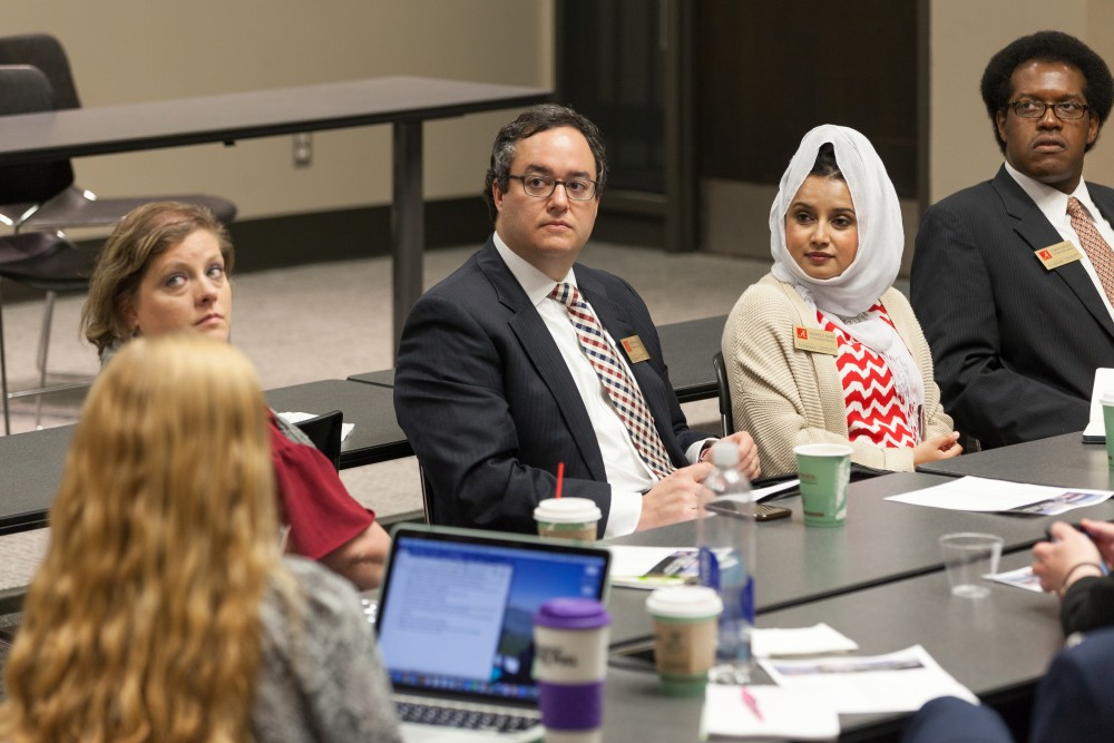 Rashmee Sharif, second from right, presides over a meeting of the Global and Community Leadership Committee.