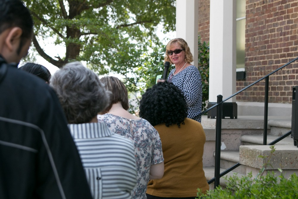 While in Pickens County for a panel discussion on the UA/Pickens County Partnership, which was initiated in 2015 to address health issues and priorities in the county, the tour group made a stop at the Pickens County Courthouse. Here, Patti Fuller speaks to the group from the steps of the courthouse, home to one of Alabama's famed ghost legends.