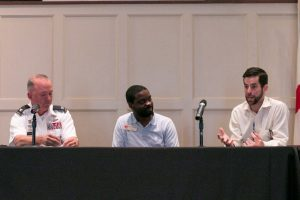 From left to right, Col. Ed Passmore, Davis Jackson, and Chris Joiner participate in a panel discussion at the Marion Military Institute Chapel in Perry County. Passmore is the Acting Commandant and Director of the Center for Service Leadership, Marion Military Institute. Joiner is Executive Director of Renaissance Marion, a nonprofit founded to improve the city's visual effect. Jackson, who served as a site coordinator for the tour, also serves as the coordinator of UA's 57 Miles Program, named for the distance between The University of Alabama and the community of Marion, where #UA students and faculty are regularly connected with opportunities to address real challenges and draw from the successes of the region, be it through a one-time service trip or a semester-long mentoring program.