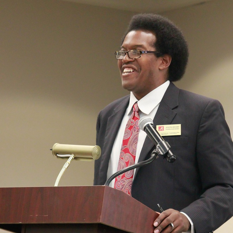 Joseph Bryant, the first African-American editor of the Crimson White, gives his report during the Monday night session. Bryant listed several projects he believes demonstrate the value of the BOA, including its scholarship program, as well as its efforts in recruiting, retaining and advising students.