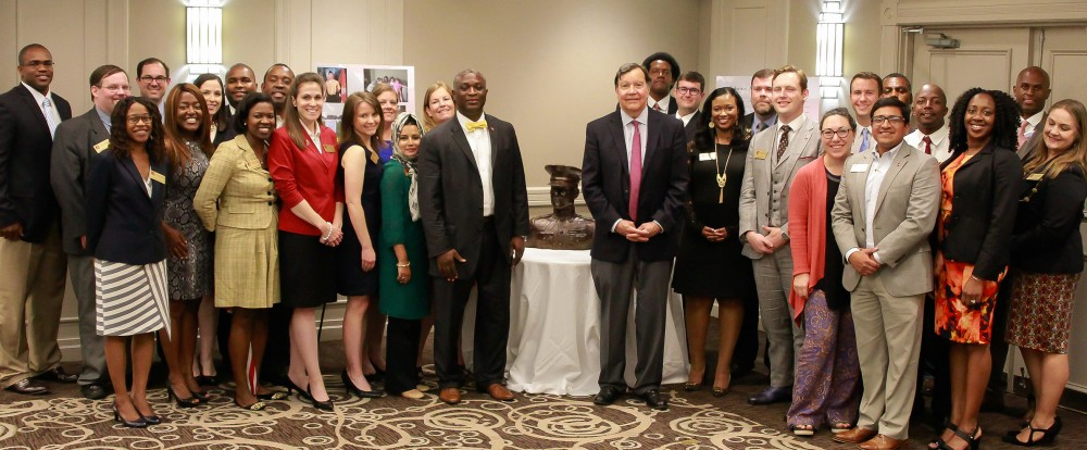 Dr. Samory Pruitt and guest speaker John Johns stand with Board of Advisors members and military representatives at the bust of Johnny Michael Spann, the first Alabamian killed in the Afghanistan War. The Board of Advisors fall 2017 meeting occurred on September 11, the anniversary of the 9/11 (2001) Twin Towers disaster.