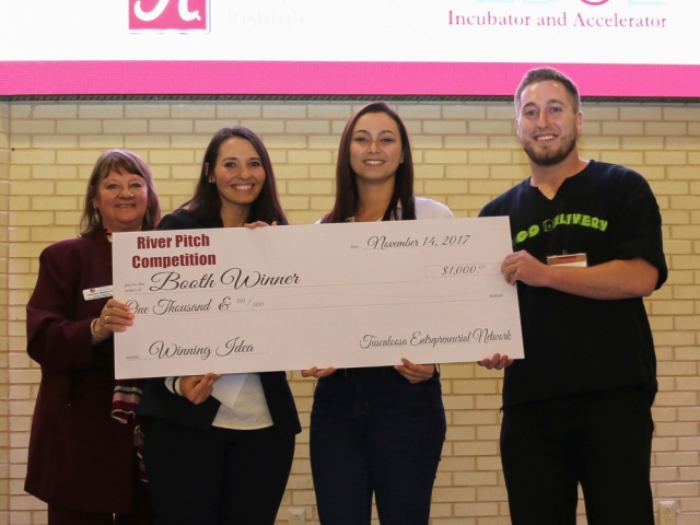 Lauren Gwin, second from right, and her winning team received $1,000 for their proposal of a line of jewelry that doubles as a self-defense mechanism if the wearer is attacked.