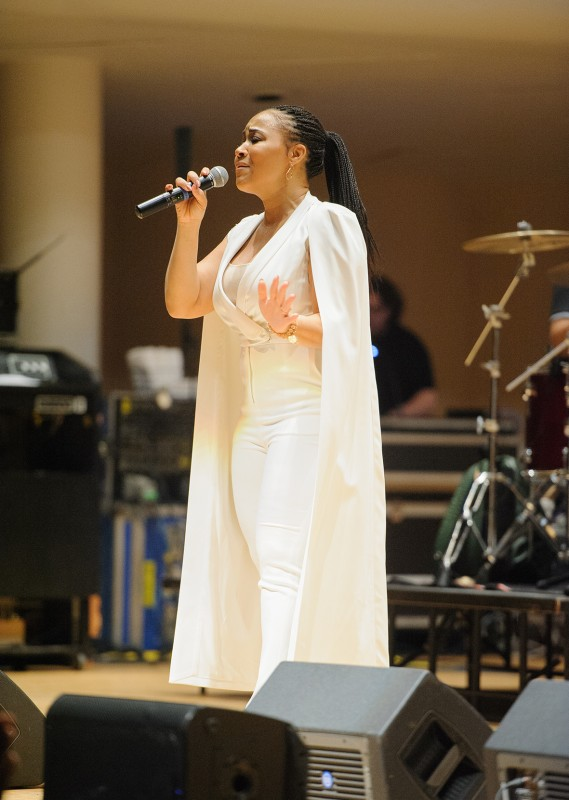 Erica Campbell brings the crowd to its feet in the Realizing the Dream concert.