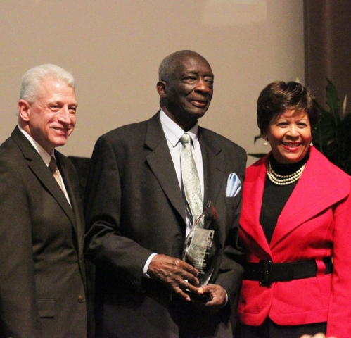 Rev. Frank Dukes, receiving Mountaintop Award, attended by Dr. Kevin Whitaker, UA provost and academic vice president, and Dr. Cynthia Warrick, Stillman College president.