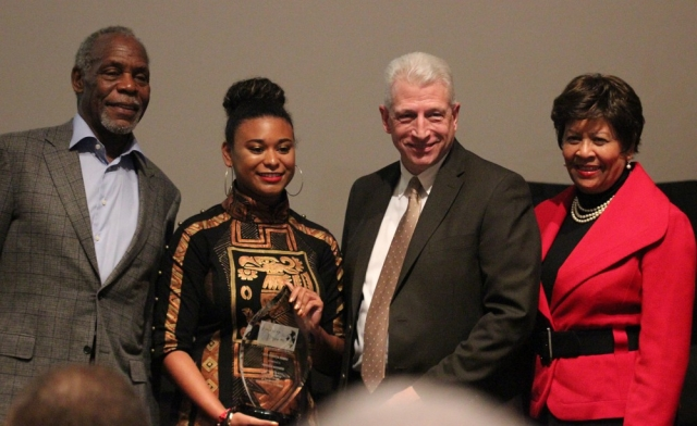 Marissa Navarro, receiving Horizon Award, accompaied by, from left, Danny Glover, Dr. Kevin Whitaker, and Dr. Cynthia Warrick.