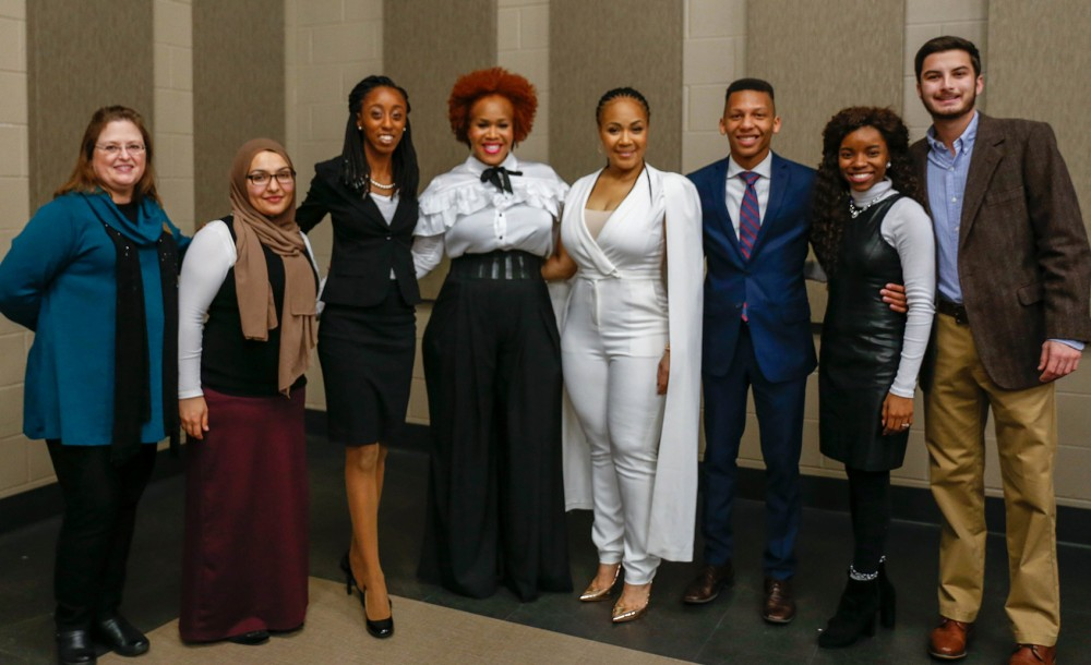 Community Affairs staff members Diane Kennedy-Jackson and Sarah Saeed pose with student leaders and featured performers Mary Mary (Tina Campbell and Erica Campbell) prior to the concert.
