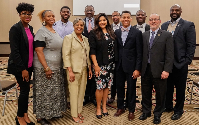 Distinguished Lecturer Julissa Arce poses for photo with representatives from the sponsoring organizations, UA, Stillman College, Shelton State and the SCLC.