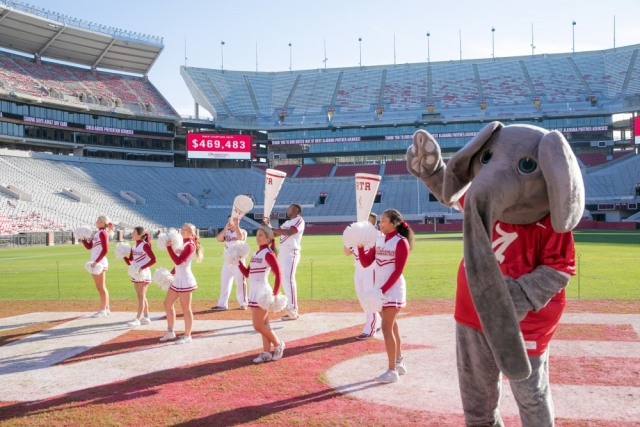 "Big Al and The University of Alabama cheerleaders led the crowd in ""Yea Alabama!"" following the announcement of the total raised — $469,483!"