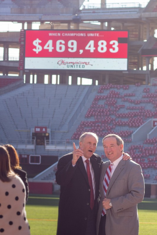 UA President Stuart R. Bell and Jordan Plaster, 2018 campaign chair, enjoy a moment together following the announcement of the total raised, displayed on the Jumbotron behind them. The 2018 campaign realized the highest dollar giving total in UA's United Way campaign history.