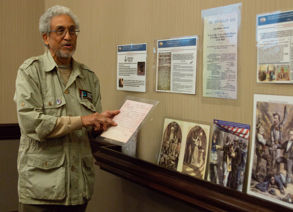 Retired NASA scientist Asa Gordon, who has dedicated his retirement years to African-Americans' role in the Civil War, comments on research artifacts as part of the RTD Distinguished Lecture Series on March 19.