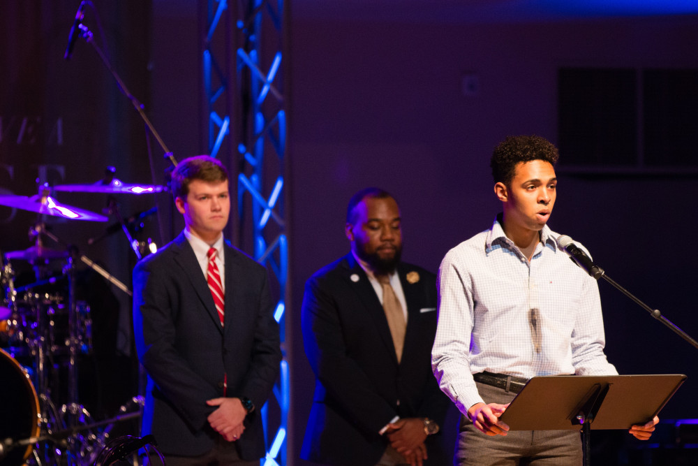 Welcoming the crowd were (at the mic) Obi Bruno S. Ndubueze, Shelton State Community College Phi Theta Kappa Honor Society president; Kylon Freeman (center), Stillman College SGA president; and Harrison Adams, UA SGA president.